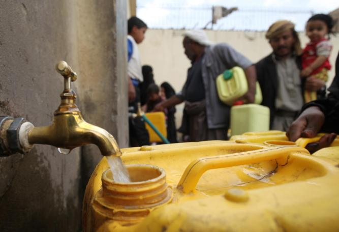 Back in April, residents fill their containers with water at outdoor taps in Sana'a.